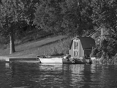 Ready to Go (Lake Effect) Tags: barn boat outboard pier river bw blackandwhite monochrome
