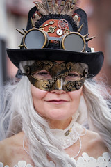Portrait from the Whitby Steampunk Weekend IV - Days Like These (Gordon.A) Tags: yorkshire whitby steampunk whitbysteampunkweekend iv dayslikethese wsw july 2018 convivial creative costume hat mask maschere culture lifestyle style fashion lady woman people street festival event eventphotography outdoor outdoors outside amateur streetphotography pose posed portrait streetportrait colour colourportrait colourstreetportrait naturallight naturallightportrait digital canon eos 750d sigma sigma50100mmf18dc