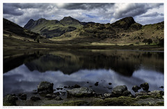Tarn Reflections (MarkWaidson) Tags: bleatarn lake district still clouds reflections rocks water dappled mountains