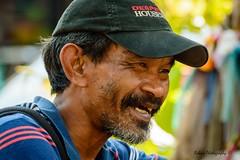 Desperate Housewives (Robica Photography) Tags: thailand bangkok street daytime sunny cap man desperate housewives smiling kind asian closeup portrait hat streetphotography robicaphotography art streetart