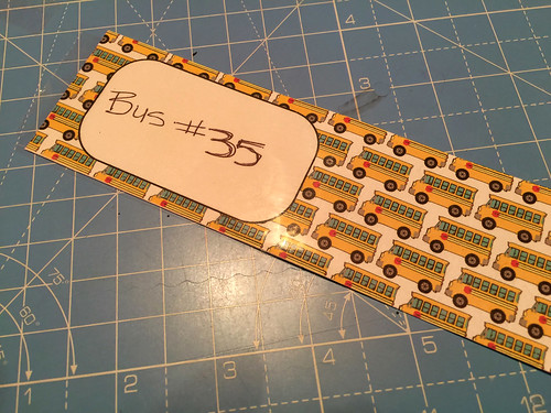 cover in packing tape backpack tags