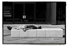 NO MAD DOGS - BUT ONE ENGLISHMAN (StockCarPete) Tags: street man sunbathing bw london uk shorts sleepingitoff