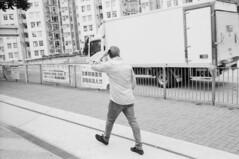 Walking (Kelvin MM) Tags: negativefilm ilforddelta400 ilford filmisnotdead blackandwhite streetphotography filmphotography filmscanner epsonv800 leicam3summaron35mmf28goggle leica leicam3