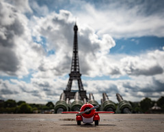 We flew into the city of Love.... (Aleem Yousaf) Tags: shadows light paris prop kid toy lost design child aeroplane happy national eiffel tower bokeh shallow depth field downtown outside world walking tourist tourism france capital vacation photography walk nikon nikkor 2470mm sky cloud cityscape cloudy cloudscape d810 classic day saturday colours colors wurope overcast historic landmark champ de mars iron wrought structure architecture dark gustave cultural