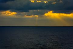 there's always the sun.. (ckollias) Tags: beauty nature cloudsky horizon horizonoverwater idyllic nopeople ominous outdoors overcast scenicsnature sea seascape sky sunrise sunriseandclouds sunrisesunsetsaroundworld sunset tranquilscene tranquility water waterfront