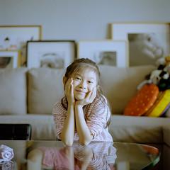 Cheeky. (MichelleSimonJadaJana) Tags: hasselblad 503cw 80mm f28 cfe carl zeiss planar medium format film analog 220 120 documentary lifestyle snaps portrait childhood children girl jada jana china 中国 shanghai 上海