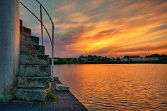 Stairway to .. (Vest der ute) Tags: xt2 norway rogaland haugesund waterscape water sky clouds stairs fence sunset houses ske fav25 lake fav200