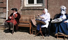 Trio in Traditional Costume (Canis Major) Tags: costumes trio historical ashdownhouse property seated attire 500 1000