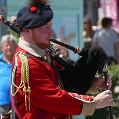 Piper Portrait (John of Witney) Tags: piper bagpipes redcoat scottish montreal quebec canada