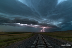 Off The Rails (kevin-palmer) Tags: wyarno sheridan wyoming july summer storm stormy thunderstorm severe weather sky clouds rain evening nikond750 railroad tracks train shelfcloud arcuscloud gustfront lightning strike bolt samyang rokinon14mmf28 green grass hills electric