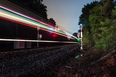 Awakened (lukeharwell) Tags: railroad railway track train passenger color streak exposure nighttime typed grs signal ge amtrak 20 bessemercity northcarolina