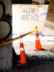 The Light Arrives on Time (Steve Taylor (Photography)) Tags: west deflo tag sign cone roadcone trafficcone construction yellow rubble gravel newzealand nz southisland canterbury christchurch cbd city glow winter sunny sunshine hazardtape orange