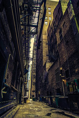 A Moment Frozen in Time (Anthonypresley1) Tags: urban chicago city alley dark street dirty road grunge spooky night architecture scene downtown nobody retro outdoor scary empty back shadow brick vintage old illuminated haunted halloween evening crime industrial black place midwest alleyway light america illinois horror lamp landscape cityscape way house building bridge twilight narrow buildings usa surreal anthonypresley anthony presley