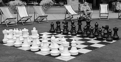 Waiting for an opponent (raymorgan4) Tags: chess checkmate chessboard white black grandmaster rook knight bishop pawn king queen fujifilm fujifilmglobal fujifilmx100f x100f cardiff bay mermaid quay deckchair