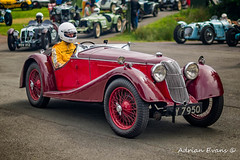 Race Day (Adrian Evans Photography) Tags: grass redcar riley radiatoremblem helmet vintage outdoor vehicle uk paddock raceday car vintagecar bonnet chrome wheel motor classiccars british driver cars sportscar badge convertible adrianevans transport