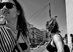 Left or right. (Baz 120) Tags: candid candidstreet candidportrait city candidface candidphotography contrast street streetphoto streetphotography streetcandid streetportrait sony a7 rome roma europe women monochrome monotone mono noiretblanc bw blackandwhite urban life primelens portrait people pentax20mm28 italy italia girl grittystreetphotography faces decisivemoment strangers