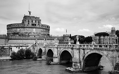 Castel Sant'Angelo(2) (S.R.Murphy) Tags: italy june2018 rome blackandwhite bw bnw whiteandblack mono monchrome architecture building ancient historicalbuilding fujifilmxt2 fujifilmxf1855mm arch river water tree sky bridge cylindrical hadrian fortress castle tower campomarzio travelphotography