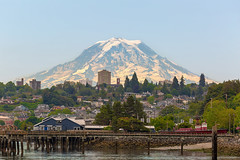 Mount Rainier by Tacoma Waterfront (David Gn Photography) Tags: mountrainier mountain snow city tacoma washington state waterfront harbor port hills scenic viewpoint dock fishing pier water realestate living travel property businesses commercial restaurants beach homes houses buildings cityscape skyline cloudy day united states pacific northwest pugetsound north america west coast closeup