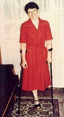 1960s Lady in Red (jackcast2015) Tags: amputee crippledwoman disabledwoman monopede crutches disabled oneleg amputeewoman woman
