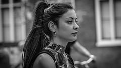 Street portait Amsterdam 18-6-32 (Pieter van de Ruit) Tags: streetportrait amsterdam netherlands streetphotography streetportret ponytails woman blackwhite zwartwit eyes hair mokumgraaf girl beauty