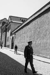Echoes (marktmcn) Tags: hradčany prague czech republic police policeman man walking cables shodow wall monochrome blackandwhite d610