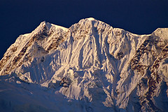 First Rays (acastellano) Tags: nepal snow mountains film topf25 topv111 sunrise trekking canon topf50 topv555 topv333 topf75 kodak topv1111 topv999 peak explore summit topv777 circuit annapurna himalayas flutes elevation75008000m mountainshimalaya annapurnaiii elaniie interestingness137 summitannapurnaiii altitude7555m royal100 abigfave dramaticnature ishflickr lpshadows2 gi1