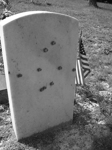 Bulletholes in one of the Stanley's gravestones.  Photo by Lucas Brown