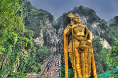 Lord Murugan's Domain (Stuck in Customs) Tags: statue stairs gold golden nikon d2x caves malaysia shiva hindu hdr batu batucaves murugan lordmurugan d2xs cavekualalumpur