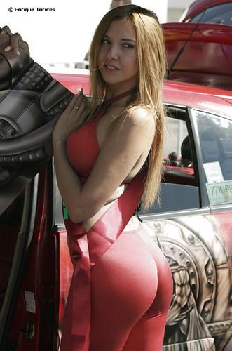 Sexy Blonde Big Ass Model posing next to retro car
