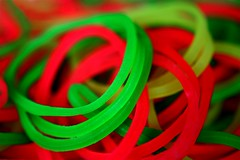 Luminosity (Neville_S) Tags: red blur macro green colors beautiful yellow circle saturated colours bokeh circles flourescent canon350d rubberband rubberbands greenandred luminousgreen saturatedcolours limeyellow luminousred luminousyellow nevillesukhiaphotography