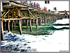 the raging ocean beneath the bridge (Kris Kros) Tags: ocean bridge summer public water photoshop photography pier interestingness high cool interesting nikon pix raw searchthebest dynamic post pacific cs2 santamonica wave ps rage pacificocean kris range hdr lumber kkg raging ragingwater 366 3xp photomatix pscs2 kros kriskros kk2k abigfave bonzag kkgallery
