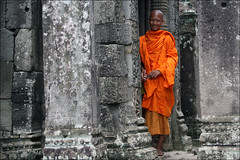 A Future Among the Ruins: Bayon (mboogiedown) Tags: world travel boy orange heritage topf25 stone asian temple ancient asia cambodia peace cambodian khmer bokeh robe buddhist south culture monk buddhism carving east holy siem reap sacred thom 17 southeast angkor wat hinduism unforgettable cultural monastic sangha bayon robes kampuchea mapcambodia cambogia theravada travelforpeace hopeforthefuture camboge beatravelernotatourist itsallaboutthepeople reasontolearnkhmer cambodiaspastandfuture dontjustseetheworldexperienceit experiencecambodia buddhistnations afutureamongtheruins livingfaith ifthephotographerisinterestedinthepeopleinfrontofhislensandifheiscompassionateitsalreadyalottheinstrumentisnotthecamerabutthephotographer~evearnold