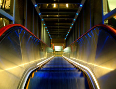 Mark II (Trapac) Tags: blue red england london yellow stairs reflections geotagged lights neon escalator staircase canarywharf dlr eastlondon docklandslightrailway ybp canarywharfstation x75 explored geo:lat=51505363 geo:lon=002075