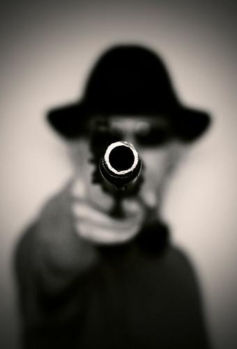 man with gun dark