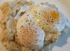 Cheese Grits with Poached Eggs (.michael.newman.) Tags: food black cheese breakfast pepper cuisine corn eat eggs cheddar culinary grits yolk poached hominy