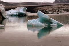 Jkulsrln Glacial Lake - Iceland ({ Planet Adventure }) Tags: favorite 20d ice gelo canon wonderful landscape ilovenature island eos iceland islandia nationalpark interestingness cool holidays flickr explorer deep diversity ab glacier backpacking 100views stunning iwasthere 300views 200views iceberg incredible tagging canoneos icebergs allrightsreserved jokulsarlon havingfun glacial skaftafell inhospitable onflickr copyright visittheworld ilovethisplace skaftafellnationalpark travelphotos 200mostinteresting facinating verycool placesilove traveltheworld breiamerkurjkull travelphotographs canonphotography thecontinuum alwaysbecapturing worldtraveller planetadventure spectacularlandscapes lovephotography specland 123faves beautyissimple theworlthroughmyeyes 20060827 peopleseemtolike icelandiclandscape supperb flickriscool loveyourphotos theworldthroughmylenses greatcaptures shotingtheworld by{planetadventure} byalessandrobehling icanon icancanon canonrocks selftaughtphotographer phographyisart travellingisfun theglaciallakejkulsrln theglaciallakejokulsarlon lagodegelo largestglaciallakeiniceland 18km depthof200mts seconddeepestlakeiniceland breidamerkurjokullglacier laterallycool stunningscenery artlibre inhospitableplace icelandiclandscapeimage copyright20002006alessandroabehling allinteresting setfrontimage alliceland justiceland greaticeland visiticeland