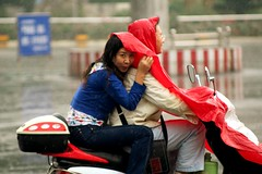 Caught In The Rain (China Chas) Tags: china street girl rain 2006 motorbike sichuan waterproof mianyang  70210mm pillion  sr316