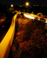 Snake or Train (gallow_chris) Tags: street travel bridge blur cars nature water night train drag lights scenery traffic natural earth hamilton scenic transportation environment terra qew warth ferma vechiles nikoncapturenx aplusphoto chrisgallow allrightsarereserved