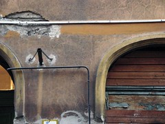 bp5759.jpg (markuci) Tags: street boards doors empty budapest pipe conduit patina arched flagholder