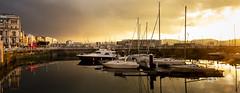 Atardecer (David A.L.) Tags: asturias asturies gijón atardecer puertodeportivo elmuelle barco barcos velero nubes agua reflejo