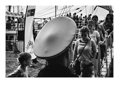 160709_00002_OM2n-fuji_antwerpen_sail (A Is To B As B Is To C) Tags: aistobasbistoc b belgium belgië europa europe antwerpen antwerp sail 2016 steenplein schelde sailor hat people boat ship flags boarding boardwalk monochrome bw blackwhite blackandwhite street streetphotography olympus om2n fuji fujifilm