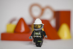 The Firefighter is going to a fire because ... well, that's what Firefighters do (N.the.Kudzu) Tags: tabletop lego miniature fireman primelens canon50mmf18 canondslr lightroom