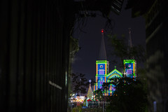 The christmas tree and the cathedral looked from small alley. (baddoguy) Tags: alley architecture awe building exterior built structure cathedral catholicism christianity christmas church cityscape color image community contrasts copy space cultures dark famous place horizontal igniting majestic multi colored narrow night no people outdoors photography poverty religion small thai culture thailand town travel destinations unusual angle variation wall feature window