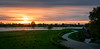 A curvy evening road (bramtop_1990) Tags: road curves curvy evening sunset grass sun orange green dusk schemer avond landscape bends house water river rivier maas trees colors color nikon d610 sigma 50mm f14 art