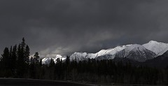 Dark Light (Jeff Saly) Tags: canmore canada alberta nature light sunlight sunset clouds dark skies canon