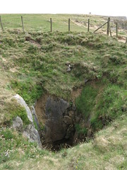 collapsed cave (squeezemonkey) Tags: pembrokeshire wales countryside broadhaven hole grass rock fence coastpath