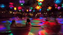 Spin me right round... (Ms. Jen) Tags: anaheim august11th august2018 california disneyland fantasyland happiestplaceonearth lumia950 madhatter madhatterteacupride photobyjeniferhanen cameraphone color lamps msjencom nightscape rides spinningride teacup unitedstates us