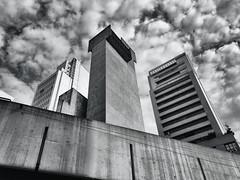 Concrete... (Diego3336) Tags: skyline skyscraper skyscrapers buildings tower downtown urban concrete architecture brutalism brutalist ventilation vent shaft ventilationshaft chimney sky clouds centrosp clicksp bw blackwhite whiteblack blackandwhite monochrome monochromatic cameraphone saopaulo sp brasil brazil southamerica latinamerica building