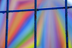 Colour separation (James_D_Images) Tags: blue metal wire construction fence mural painting colour spectrum geometric lines bokeh purple orange yellow red green colourful abstract