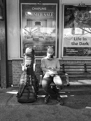Life in the dark (IanAWood) Tags: rickmansworthstation rickmansworth hertfordshire tfl londonunderground onthetube humansbeing candid streetphotography seeinginblackandwhite amonochromelife lightandshade thisislife flaneur strangersatthestation androidphotography cameraphonephotographer mobilesnaps capturedonp9 huaweip9 editedinsnapseed seenonmytravels notwalkingwithmynikon